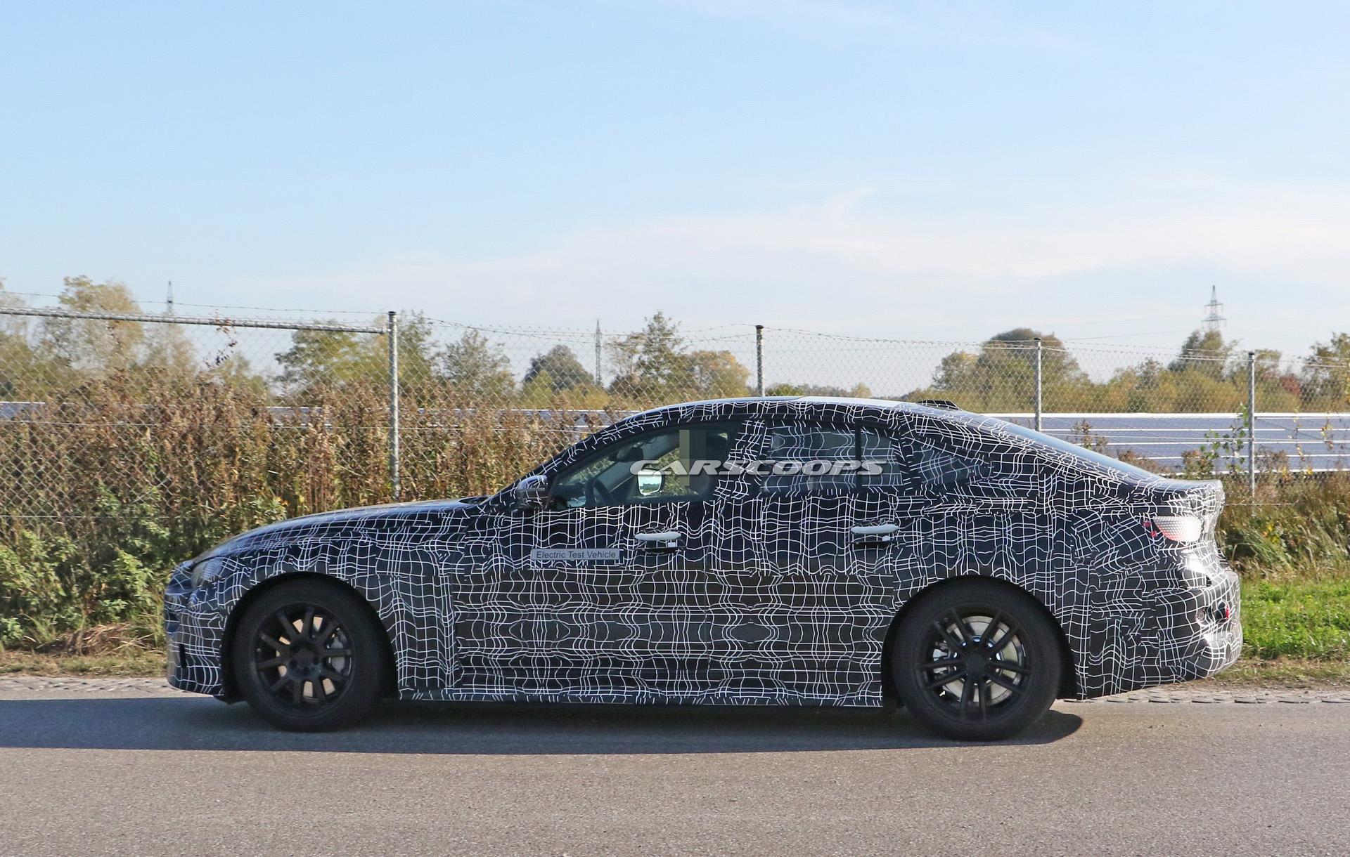 bmw-i4-spied-thinner-camo15